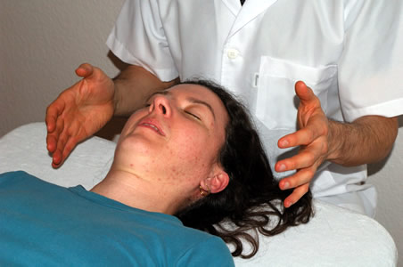 Marcos performing a Facial lift massage as part of a client treatment</perch:content>