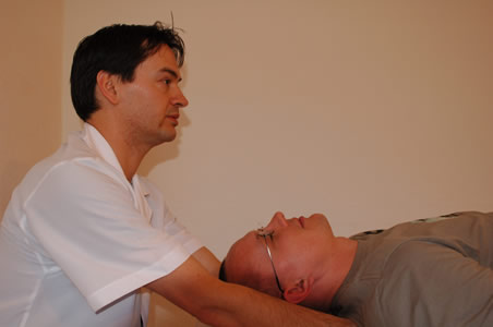 Marcos performing a polarity therapy as part of a client treatment</perch:content>