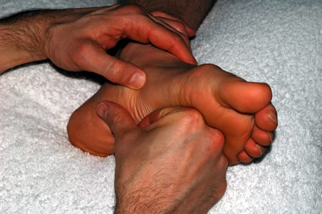 Marcos performing Reflexology