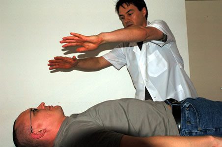 Marcos performing a Polarity therapy technique as part of a client treatment</perch:content>